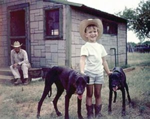 "02. Jeffrey Preston Bezos, age five, with his grandfather, Lawrence Preston ""Pop"" Gise, in Cotulla, Texas, in 1969"