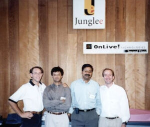 12. Jeff Bezos with Junglee executives (l-r) Brian Lent, Rakesh Mathur, and Ram Shriram, an early Google investor