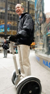 15. Bezos stands on a Segway in 2002 as the ill-fated electric-powered transporter goes on sale exclusively at Amazon for $5,000