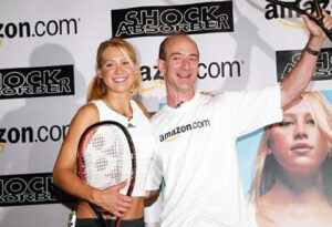 18. Bezos and tennis pro Anna Kournikova after an exhibition round of tennis at New York's Grand Central Terminal