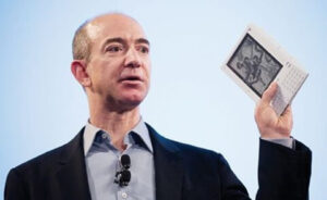 20. Bezos introduces the original Kindle e-reader at a news conference in New York City on November 19, 2007