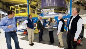 24. NASA deputy administrator Lori Garver (third from right) takes a tour of the Kent, Washington, headquarters of Blue Origin